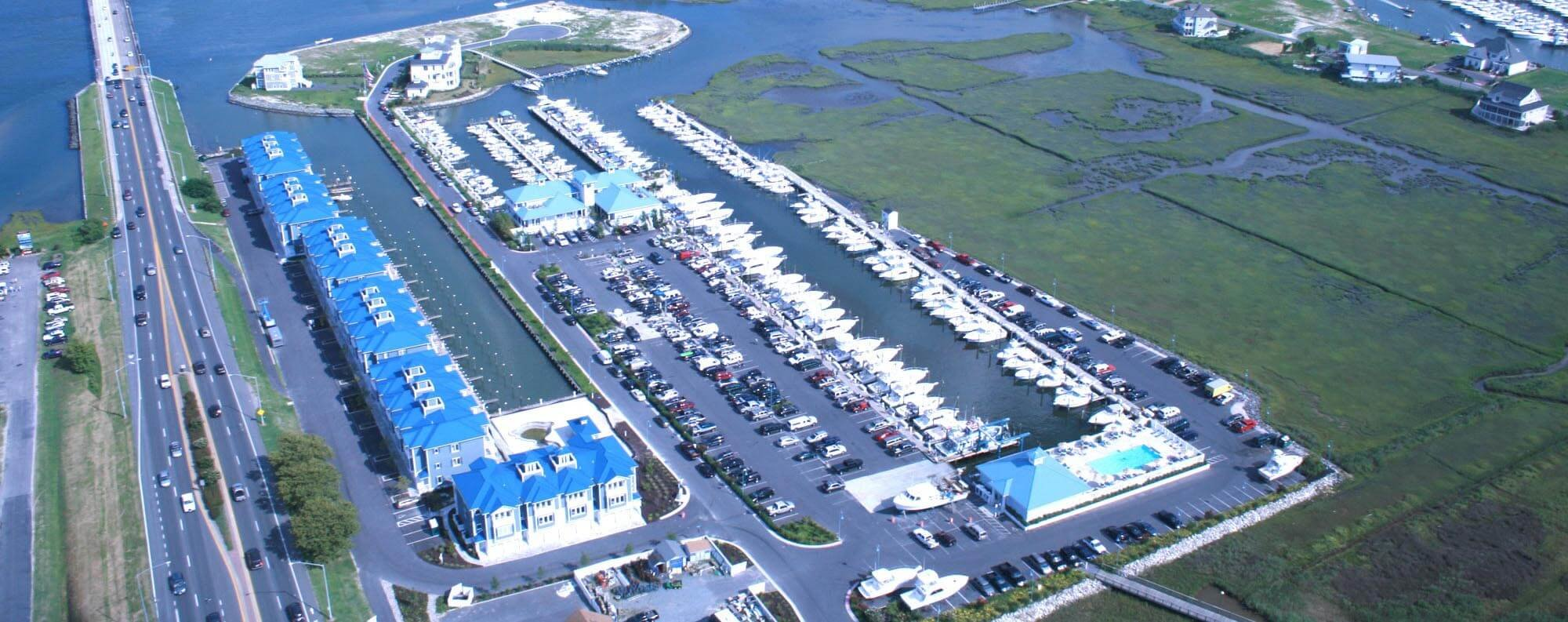 An overhead view of the marina next to the highway