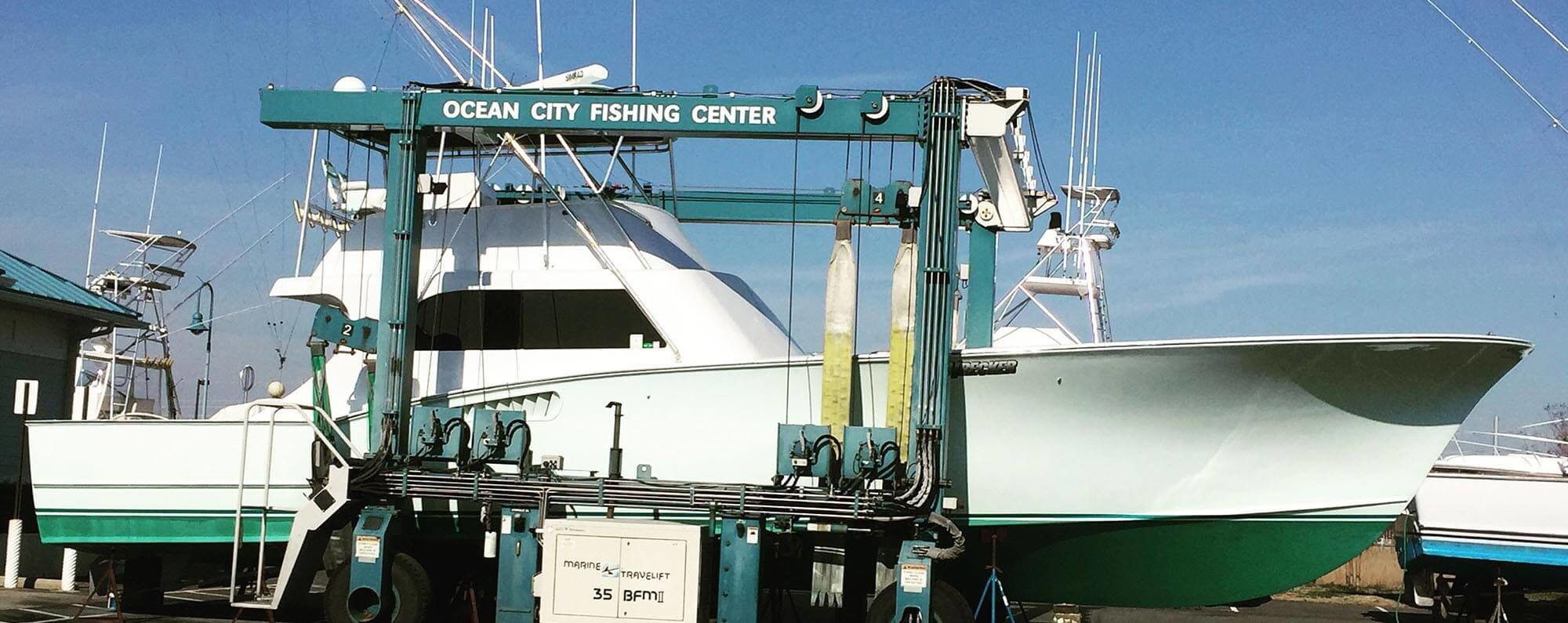 Ocean City Fishing Center travel lift carrying a boat